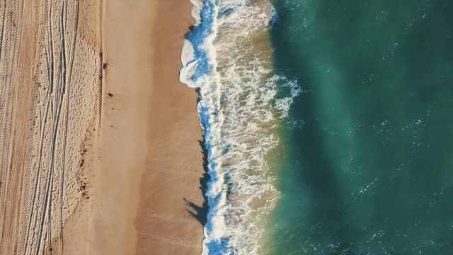 ocean beach from drone point of view - coastline stock videos & royalty-free footage