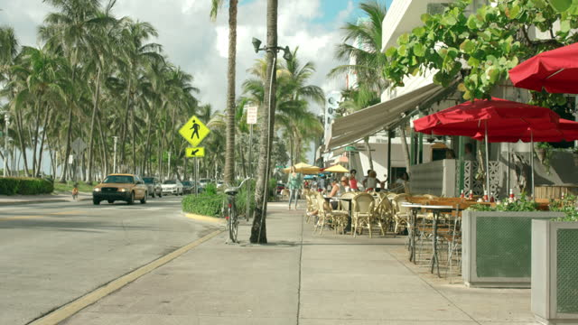 ocean drive, art deco hotels, south beach - gulf coast states stock videos & royalty-free footage