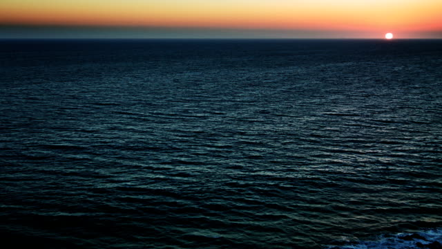 ocean half water with sunset sky - indian ocean stock videos & royalty-free footage