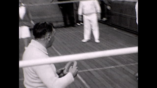 ocean liner empress of australia / view of passengers playing a game on the sports deck - 1930点の映像素材/bロール