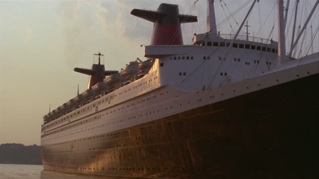 1969 montage ms ocean liner in harbor/ ws pan zi to text, 'france', on starboard side of vessel/ manhattan, new york, usa - passenger ship stock videos & royalty-free footage