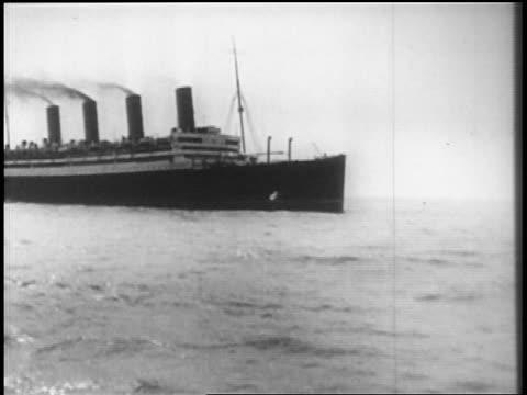 stockvideo's en b-roll-footage met b/w 1928 ocean liner sailing on ocean / newsreel - 1928