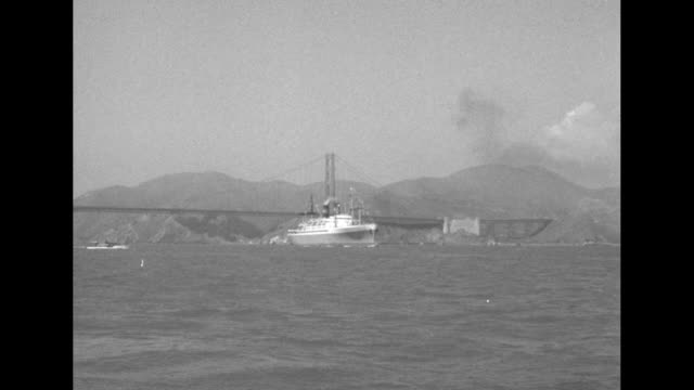 ls ocean liner ss president wilson carrying crown prince akihito golden gate bridge and mountains in bkgd / ms ss president wilson with smaller boat... - japanese royalty stock videos and b-roll footage