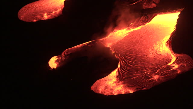 ocean meets molten lava from erupting volcano, big island, hawaii - molten stock videos and b-roll footage