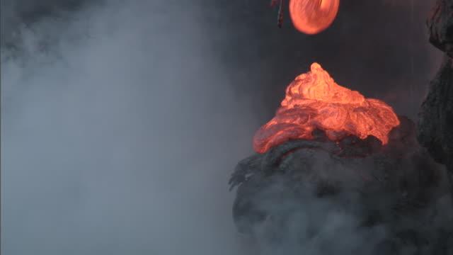 ocean meets molten lava from erupting volcano, big island, hawaii - erupting stock videos & royalty-free footage