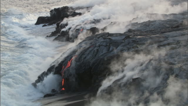 Ocean meets molten lava from erupting volcano, Big Island, Hawaii