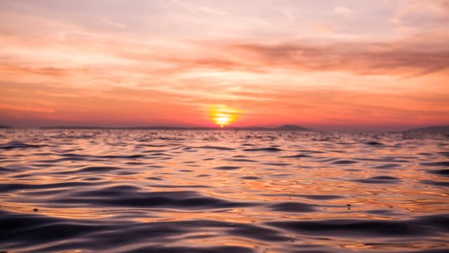 ocean slowly waving at sunset - horizon over water stock videos & royalty-free footage