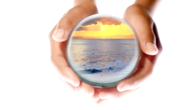 ocean sunset in hands - crystal ball stock videos & royalty-free footage