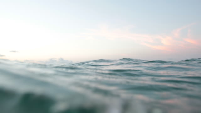 POV Ocean surface at sunrise