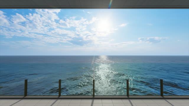 vídeos de stock, filmes e b-roll de vista para o oceano de uma varanda no mar, vídeo de estoque do pôr do sol - sacada