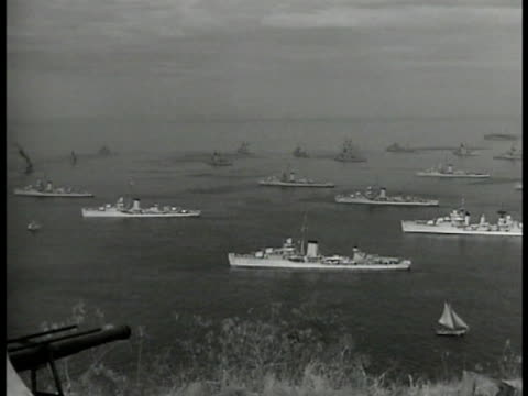 ocean w/ large & small us warships on water . mot 1940: governor-general tjarda stachouwer talking w/ dutch officials. - 1940 stock videos & royalty-free footage