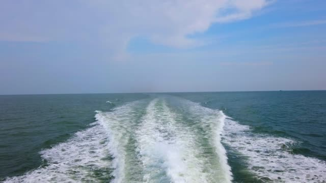 ocean wake from cruise ship, on bright summer day.view from superdong ship on the way to con island, vietnam - wake water stock videos & royalty-free footage