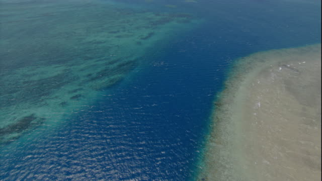 Ocean water ripples above the Great Barrier Reef. Available in HD.