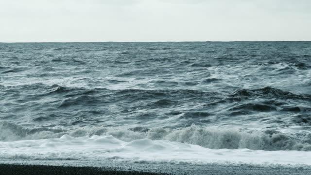 Ocean waves breaking on the shoreline