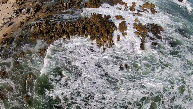 ocean waves crashing against the rocks - tidal pool stock videos and b-roll footage