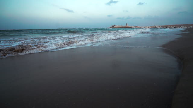 ocean waves crashing on beach at sunrise - gulf countries stock videos & royalty-free footage
