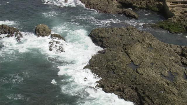 aerial ws td ocean waves crashing on rocks / cascais, lisbon, portugal - cascais stock videos and b-roll footage