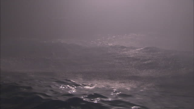 ocean waves heave during a storm. - weather stock videos & royalty-free footage