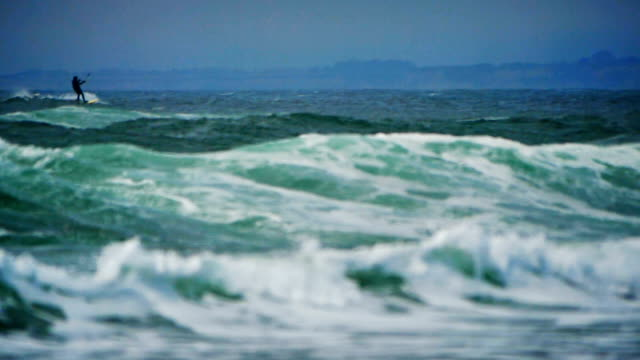 ocean waves in super slow motion. - kite sailing stock videos and b-roll footage