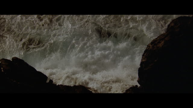 ha, slo mo ocean waves splashing on rocks - ominous stock videos & royalty-free footage