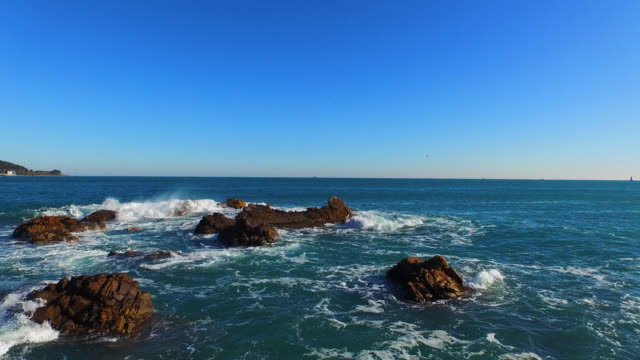 ocean waves / ulsan, south korea - boulder rock stock videos & royalty-free footage