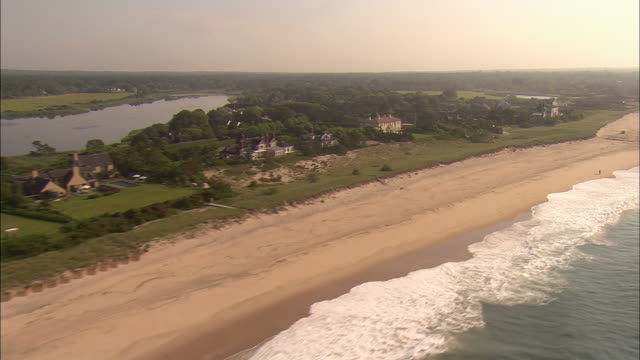 AERIAL, Oceanfront mansions along beach at east end of Georgica Pond, East Hampton, New York, USA