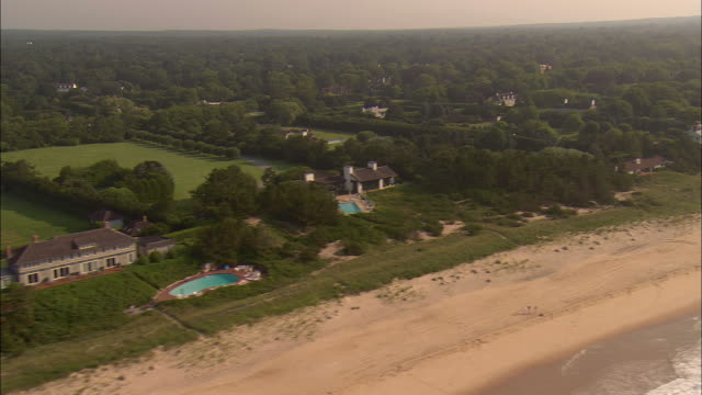 AERIAL, Oceanfront mansions along beach at  Lily Pond Lane, East Hampton, New York, USA