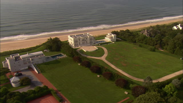 aerial, oceanfront mansions along beach at  lily pond lane, east hampton, new york, usa - long island stock videos & royalty-free footage