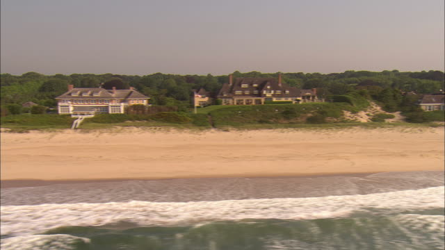 low aerial, oceanfront mansions at  lily pond lane, east hampton, new york, usa - long island stock videos & royalty-free footage