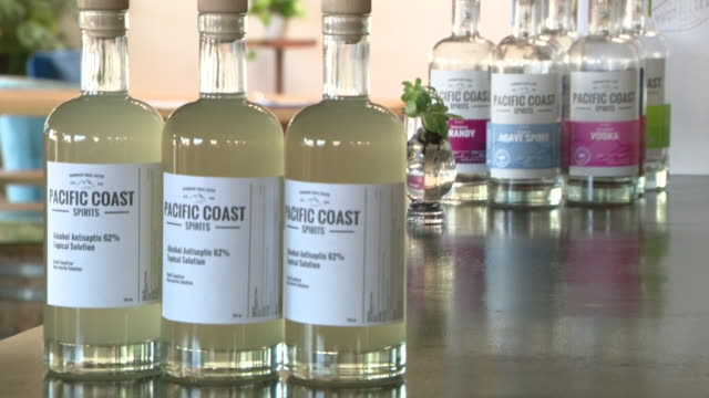 oceanside, ca, u.s. - bottles with hand sanitizer produced in pacific coast spirits distillery during coronavrus outbreak, on monday, march 23, 2020. - alcohol drink stock videos & royalty-free footage