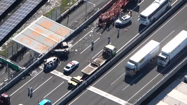 a sevenvehicle pileup left at least 15 people injured and three cars on fire on an expressway in the central japan prefecture of aichi on tuesday... - traffic accident stock videos & royalty-free footage