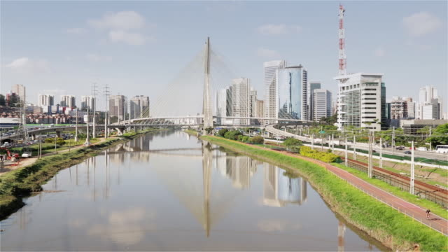 ms octavio frias bridge and av das nacoes unidas with reflection in river in brooklin novo / sao paulo, brazil - cable stayed bridge stock videos & royalty-free footage