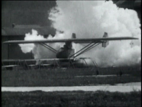 October 10, 1929 MONTAGE Pilot attempting to fly in rocket airplane / Frankfurt, Germany