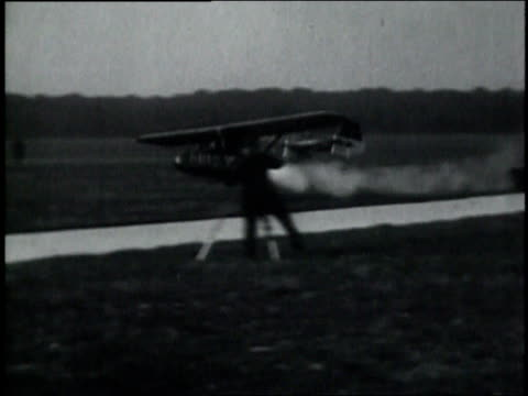 october 10, 1929 ws pilot flying in rocket airplane / frankfurt, germany - 1920 1929 video stock e b–roll