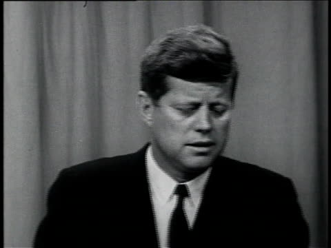 October 11 1961 MONTAGE President John F Kennedy taking questions from the press at a news conference about Vietnam joking with press and speaking...