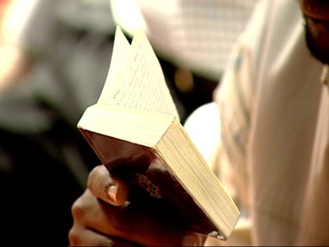 october 12 2001 zi man reading the koran / falls church virginia united states - falls church video stock e b–roll