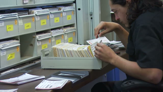 october 13 2008 zo clerk looking through files / new mexico - filing cabinet stock videos & royalty-free footage