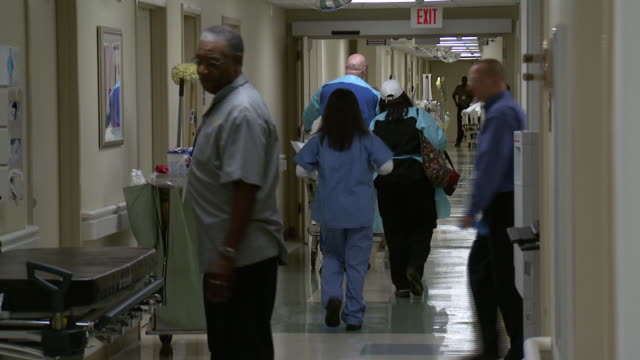 October 14 2009 WS Hospital staff and patients walking in busy hospital corridor / Memphis Tennessee United States