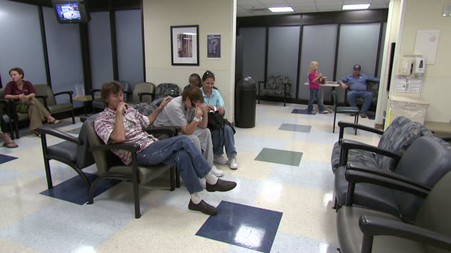 october 14 2009 pan patients sitting in hospital waiting room / memphis tennessee united states - waiting room stock videos & royalty-free footage
