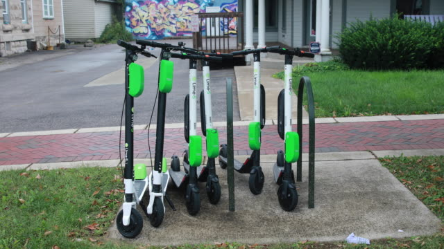 October 14 2018 Lime scooters are left parked on the sidewalk along Kirkwood Avenue after being juiced in Bloomington Indiana Several weeks ago...