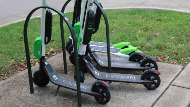 october 14 2018 lime scooters are left parked on the sidewalk along kirkwood avenue after being juiced in bloomington indiana several weeks ago... - lime stock videos & royalty-free footage