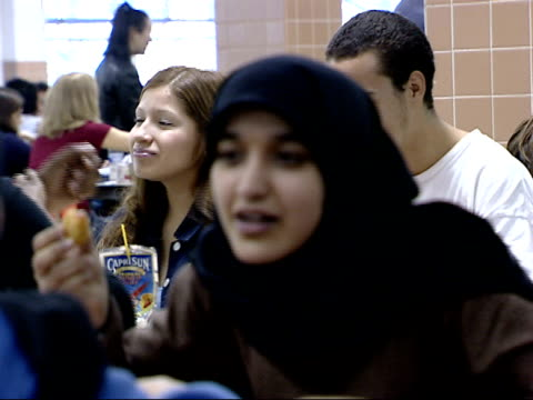 october 15, 2001 montage students eating in a cafeteria, including two girls with muslim head scarves / falls church, virginia, united states - falls church stock videos & royalty-free footage