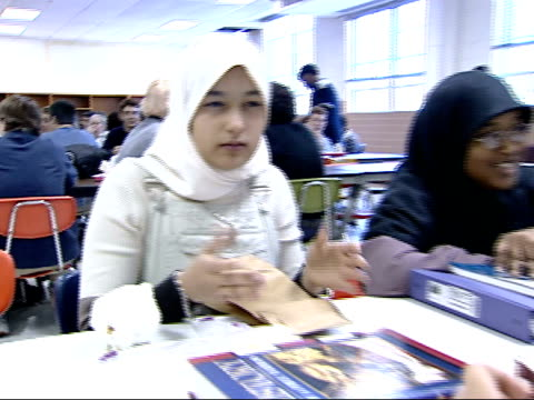 october 15, 2001 montage students eating in a cafeteria, including girls with muslim head scarves / falls church, virginia, united states - falls church stock videos & royalty-free footage