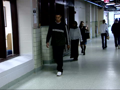 october 15 2001 ts students and teachers walk the halls of a high school including a muslim student with a scarf / falls church virginia united states - falls church stock-videos und b-roll-filmmaterial