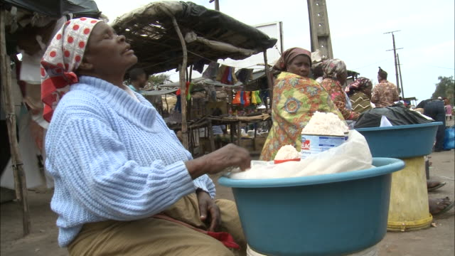 october 15 2010 ms vendors sitting with their goods outside booths and tents in flea market / mozambique - booth stock videos & royalty-free footage