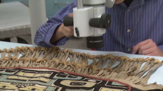 october 17, 2008 smithsonian institution conservator examining textile artifact with microscope / washington, d.c., united states - one mid adult man only stock videos & royalty-free footage