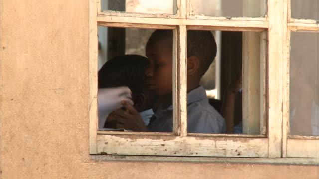 October 19 2010 PAN Elementary school students seen through open windows of schoolhouse during classroom studies / Mozambique