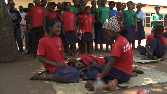 october 19, 2010 group of elementary school students perform a skit during outdoor health and safety class / mozambique - sketch comedy stock videos & royalty-free footage