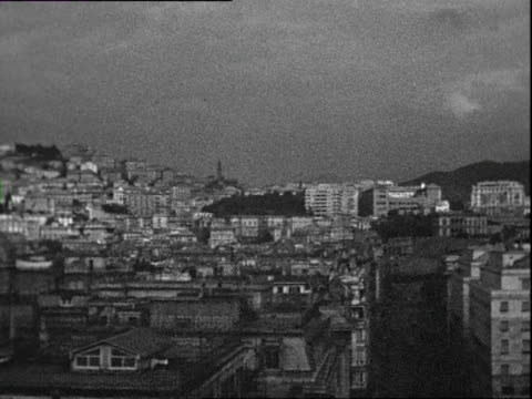october 1936 b/w ws pan cityscape with piazza della vittoria / genoa, italy - liguria stock videos & royalty-free footage