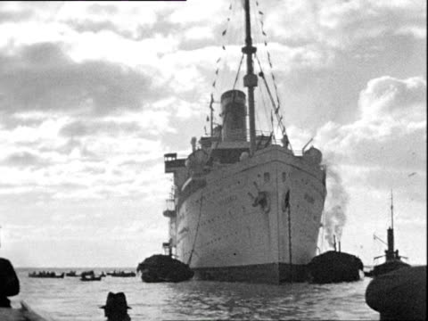 vídeos de stock, filmes e b-roll de october 1936 b/w montage ocean liner disembarking, passengers on small boat in bay of biscay / madeira, portugal - oceano atlântico